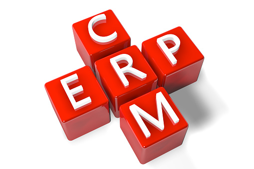 3D Render Crossword concept: Enterprise Resource Planning (ERP) and Customer Relationship Management (CRM)